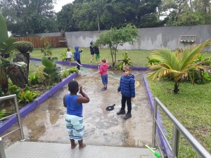 Kids making the most of the rain!